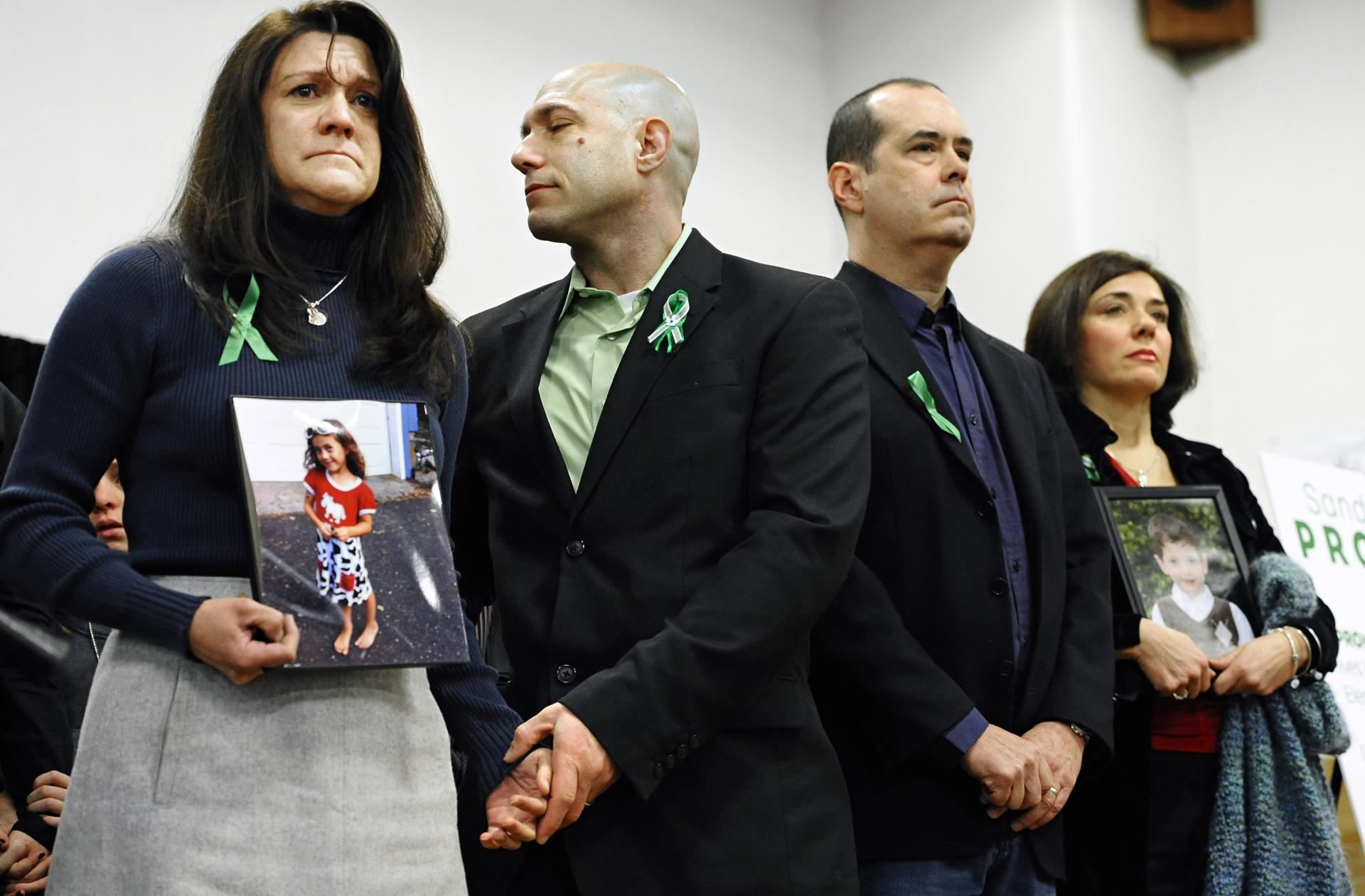 Jennifer Hensel (left) and Jeremy Richman (center left), parents of Sandy Hook shooting victim Avielle Rose Richman, at a news conference at Edmond Town Hall in Newtown, Conn., a month after the shooting.